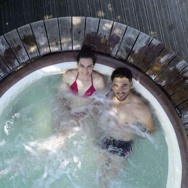 Aerial view of couple in jacuzzi